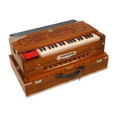 Harmonium, Scale Changer Folding, Sardar by Monoj Sardar. $1444.15. Deluxe, 5 drones and 4 stops. Keyboard pops up, store in locked-down position for travel. Mechanical coupler (plays 2 octaves with one stroke). Keyboard slides to change scale. Integral bellows, dozens of sound combinations. Finish color and decoration style may vary from photo. The Harmoniums are not meant to be played in concert like a mini organ. This is instrument was introduced to India by...