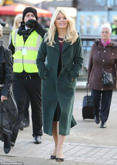 Winter's here: Holly Willoughby looked super chic as she left the warmth of the This Morning studio during Wednesday's show to get some tips on the perfect roasted chestnut