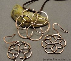 These earrings and pendant are so cool - flower shape wire wrap. Handmade.