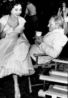 Elizabeth Taylor and Spencer Tracy taking a break on the set of 'Father of the Bride', 1950.