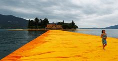 """For 16 days, """"The Floating Piers,"""" a saffron-colored walkway, will connect two small islands in a lake in Northern Italy to the mainland."""