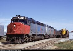ARDMORE OK October 1973 -- The southbound Texas Chief rolls toward the Amtrak station. Leading the way is SDP40f 508. In the background is Santa Fe GP7 2742.