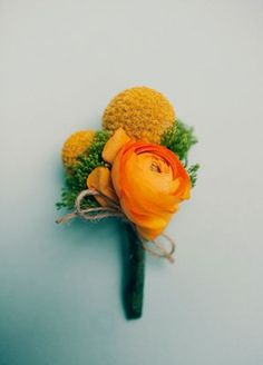 This vibrant boutonniere is perfect for prom or a spring wedding. This is too yellow orange. Ranunculus Boutonniere, Corsage And Boutonniere, Boutonnieres, Groom Boutonniere, Orange Boutonniere, Woodsy Wedding, Floral Wedding, Wedding Flowers, Wedding Ideas
