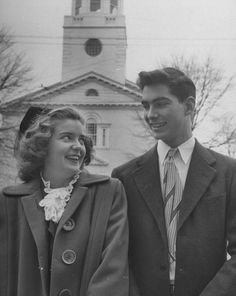 A teenage couple smile at each other walking from church, Atlanta, Georgia, 1948.