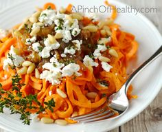 Spiralizer Sweet Potato with Goat Cheese, Caramelized Onions and Pine Nuts| APinchOfHealthy.com