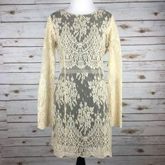 """[Free People] Lacey Bodycon Dress Sand Boho Chic Delicate lace Bodycon mini dress featuring sheer long sleeves and scalloped trim. Rounded neck with a low scoop back. Lined. Hidden side zip.  Color: Sand Fabric: Nylon & Rayon Size: Small Bust: 17"""" Length: 32"""" Condition: NWT!  No Trades! No PayPal! Free People Dresses Long Sleeve"""