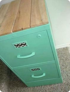 painted file cabinet, chevron inserts and wooden top. very shabby chic