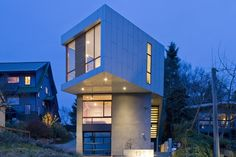 Building Outside the Box - a 2,600-square-foot, three-bedroom ultramodern residence made of white aluminum panel siding and stucco cantilevers 20 feet over a driveway, twisting slightly at the top. The living room and kitchen are on the highest floor, to get the best light, and the bedrooms are down below. The house cost $575,000 and took a year to design and build. Wall Street Journal, By Nancy Keates, Seattle 4/12/2012