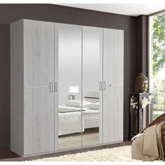 This Anna FourDoor Mirrored Wardrobe from Wimex UK offers you plenty of storage with a...