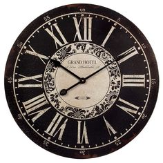 "Black and White, Grand Hotel wall clock. Dimensions: 23.25"" diameter Material: MDF 100%"