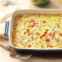 Chive-Ham Brunch Bake Recipe -This recipe is a hearty dish that look as great it tastes. It has a pleasing and colorful mix of tomatoes, onions and cheese.—Edie DeSpain, Logan, Utah