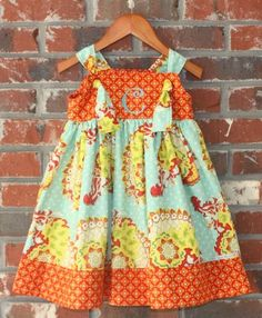 Livi Stitches: Pillowcase Dress -like one of necklines with button.