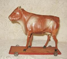 "Early 8"" Stick Legged Cow on Platform with Wheels ~ SOLD"