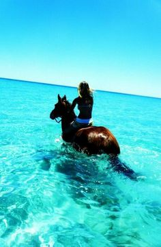 Bareback riding in the ocean, Jamaica. One with nature. Incredible.