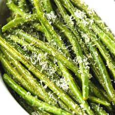 These oven baked green beans with parmesan cheese are simple to prepare and ready in under 30 minutes. Perfect for a healthy side dish or a light meal. #greenbeans