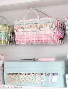 17 Fabulous Creative Storage Solutions For Your Studio Hanging Baskets with Fabric - If you're in need of craft storage ideas for your craft room then this list is exactly what you need to read! Sewing Room Organization, Craft Room Storage, Fabric Storage, Craft Rooms, Bathroom Organization, My Sewing Room, Sewing Rooms, Space Crafts, Home Crafts