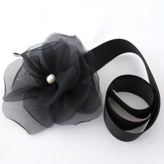 Black band with organza flower and a small pearl