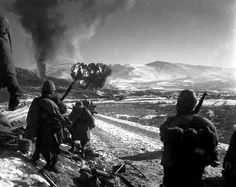 Korean War - HD-SN-99-03091 by Morning Calm News, via Flickr  U.S. Marines move forward after effective close-air support flushes out the enemy from their hillside entrenchments. Billows of smoke rise skyward from the target area. Hagaru-ri. December 26, 1950. Cpl. McDonald. (Marine Corps)  NARA FILE #: 127-N-A5439  WAR & CONFLICT BOOK #: 1432