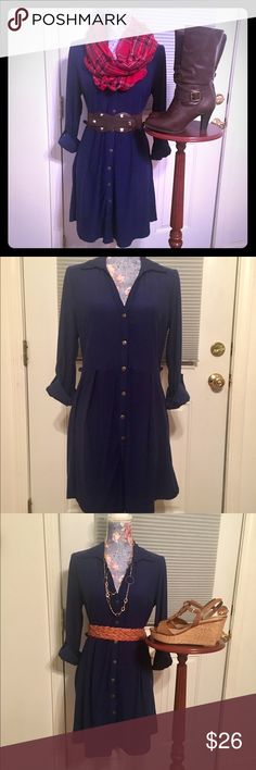 👄Stylishly Sexy Navy Blue Dress! Sz Lrg👄 👄Incredibly versatile & trendy!  Throw on a scarf & boots, or add a cute belt & a pair of wedges, or wear it over a pair of leggings!                                                               👄This super soft, stretchy & flowy dress features rich dark/navy blue material, collared V-neck, bust to hem bronze-toned buttons, buttoned roll-cuff sleeves, elastic waist & belt loops!  🚫This listing is for dress only!  Accessories used for styling…