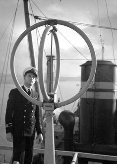 AWA Radio Marine and DF equipment on board Taiping ship with portrait of ship's captain. Max Dupain photo, c 1954.
