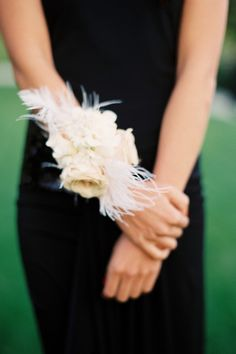 corsage - But look @ this with RED Roses and Black Feathers... COOL!!!