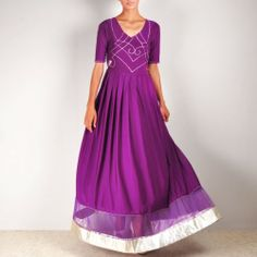 Hera Angrakha Go for this lycra angrakha cum wrap dress with embroidered bodice and net hemline. This can be worn as a gown for parties and can be teamed with bottoms for Indian occasions. Shop here: http://www.tadpolestore.com/ #suits #mauve #purple #anarkali #Indian #ethnic #embroidery