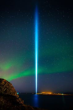 ↝ Near Reykjavik, Iceland: the Imagine Peace Tower is a memorial to John Lennon from his widow Yoko Ono, who plans to have the tower lit ann...