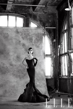 1950's fashion, beautiful. Sadly, the model looks like she was starved, and the make up, to make her look further gaunt.