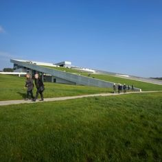 Visitors to Henning Larsen's Moesgaard Museum  can walk over its grassy sloping roof