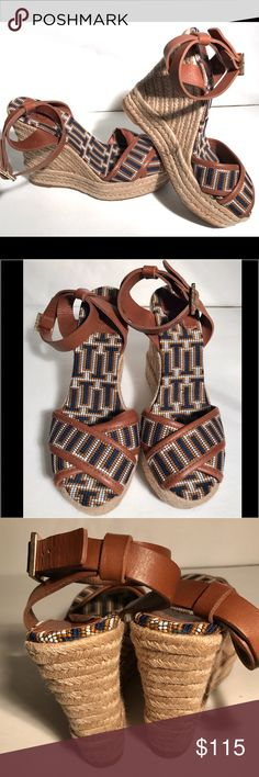 "Tory Burch espadrille wedges Tory Burch espadrille wedges.  Absolutely gorgeous navy blue and tan espadrille wedge sandals.  Tan leather straps around ankle, criss cross over toes.  Flawless condition, except the TB label inside the left shoe is lifting.  Easy fix!! 5"" tall Tory Burch Shoes Espadrilles"