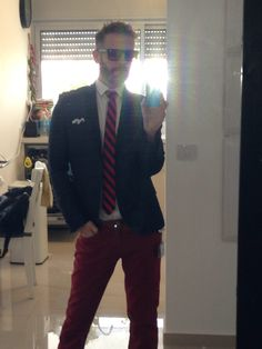 Castro's red pants H&M Dark Blue Blazer H&M Blue & Red striped tie H&M Blue & White Pocket Square  Zara Brown Leather shows Carolina Lemke brown wood sunglasses