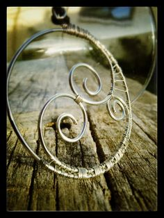 Double Koru or spiral pendant in silver...symbolizes the duality of the universe, new beginnings and the idea that everything comes full circle.