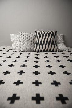 """Black and white """"plus"""" design quilt, minimalist."""