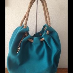 """Michael Kors MARINA Canvas Large Gathered Tote Beautiful Michael Kors MARINA Gathered Bag in Turquoise - 100% Authentic - Very good condition except for the slight fading on the back of the bag -Clean interior - Rope handles with tassel Pockets & hidden side zipper -Length: 15"""" (narrowest) - 21"""" (longest) Width: 7""""-  Height: 13"""" Shoulder Strap Drop: 10"""" RV$248 Michael Kors Bags Totes"""