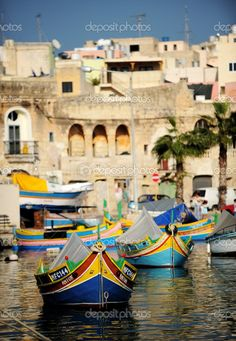 Colourful boats moored in a Maltese harbour.