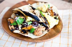 Mushroom and black bean breakfast tacos with crumbled cotija cheese and fresh cilantro inside of corn tortillas.