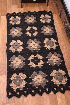 by the bed  (Granny square rug made with t-shirt yarn... what a lovely Idea)