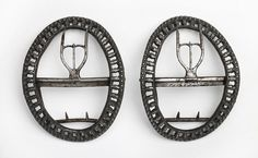 Shoe buckles    Pair of cut steel buckles made for a man's shoe by John Sharp of Birmingham in about 1780.    Accession number: 1935 F93.1-2