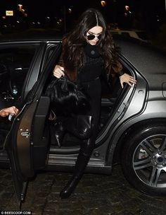 Kendall Jenner leaps out of the way of her runaway vehicle in Milan | Daily Mail Online
