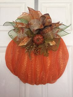 Handmade Fall/Autumn Deco Mesh Pumpkin Wreath with Ribbon Bow  Made with a wire wreath, chenille stems, deco mesh, ribbon, and decorative sprig of leaves/berries.  Deco mesh is Orange in color, rolled up to look like a real pumpkin!  Ribbon includes: Stripe glitter, sheer orange glitter, plaid, pumpkin print, and a leaf print.  Measures approx. 16 wide x 18 tall x 8 in depth.  Would be great on a door or even the wall!  Wreath is made and ready to go! Free Shipping!!! I will have the item…