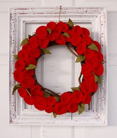 Obsessing recently re wreaths and felt.  This is perfect.