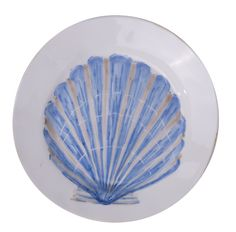 Scallop Shell Handmade Earthenware Plate: Bring the mediterranean into your home! Hand moulded, painted and glazed this is truly an artisan product crafted in Italy. Sturdy and robust and of generous proportions this collection of ceramics will always make one think of summer. Each plate is hand finished on the edge to create a worn, timeless finish. Inspired by the sea the designs are painted in fresh tones of blue to evoke the atmosphere of the Italian seaside.