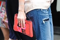 Pin for Later: New York's Street Style Accessory Game is Hard to Beat  A cutesy clutch paired with subtle body jewellery.
