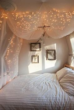 hang christmas lights behind sheer curtains for a luminescent effect.