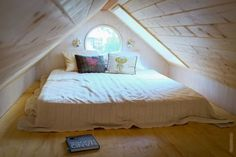 Great idea for making a small room look bigger. May work well for an old attic turning into a beautiful bedroom too.