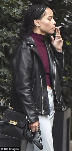 Smoking hot: The 26-year-old star puffed away on a cigarette during the outing in the Big ...