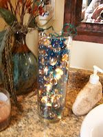 Easy nightlight...perfect for bathrooms, it's just a vase, irredescent rocks, and a small christmas light string...cheap, easy and pretty!