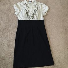 Trixxi Dress with Polka Dot Top and Black Bottom Fairly New Trixxi Polka Dot Button Top Dress With a Black Bottom. Ruffle Detail on Collar with Runched Sleeves. Only worn once. Polyester, Rayon, and Spandex. Trixxi Dresses Midi