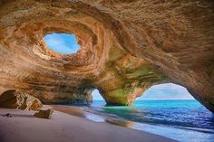 Cave in Algarve, Portugal. The Algarve region in Portugal, where this cave is located, is prone to various seaside formations because of the rock face's relative solubility in water. This specific cave near Lagos is accessible only by water. Beaches In The World, Places Around The World, Around The Worlds, Best Beaches In Portugal, Portugal Travel, Faro Portugal, Albufeira Portugal, Portugal Trip, Lagos Portugal Beach