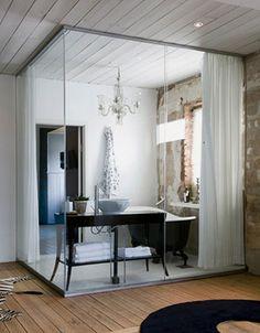 interior glass wall bathroom in a villa